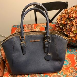 Navy Michael Kors satchel.